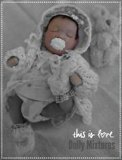 hand sculpted polymer clay baby