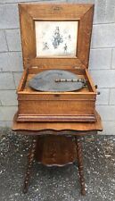 "15 1/2"" Regina Oak Double Comb Disc Music Box With Oak Stand"