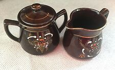 VINTAGE GLASS SUGAR AND CREAMER SET BROWN WITH FLOWERS  AND GOLD TRIM UNBRANDED