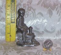 RICKER BOY ON TRAIN COLLECTIBLE PEWTER FIGURINE 3 AND 3/4 INCHES TALL