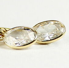 14k Yellow Gold 8x6mm Oval Cubic Zirconia Leverback Earrings