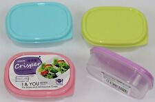 Set of 4 Mini Storage Containers Made of plastic with removable lids.