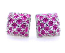 Small and sweet crystal stud earrings. Studded with tiny pink and clear crystals