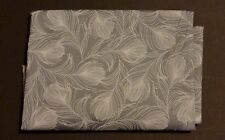 one metre cotton poplin with large white feathers on mid grey