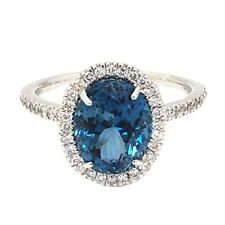 18k White Gold Halo Ring 3.62cts Oval shape Blue Topaz & .33cts Round Diamonds
