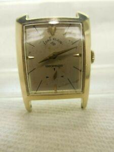 LORD ELGIN,1950'S,21J.,MAN.WIND WATCH, # 713,14K,GF HOUR GLASS ASYMETRICAL CASE
