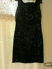 Per una size 8 little black dress,fully sequinced,sleeveless,silky band at waist