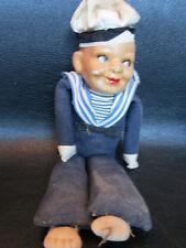 Four Antique sailor dolls