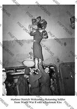 Marlene Dietrich welcomes a soldier returning from World War 2 with a Kiss