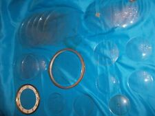 25 Pieces Of New and Used Flat And Curved Glass For Clock Doors And Frames