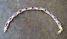 14k Yellow Gold Tennis Bracelet with 11 Amethyst Jewels W - 8.9 g. L- 7 1/4''