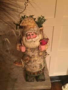 Birch log Santa with nature theme with log feet, animals popping out of sides