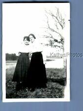 FOUND B&W PHOTO D_1061 PRETTY WOMEN IN DRESSES POSED IN FIELD