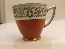 Mintons orange white and gold demitasse cup.