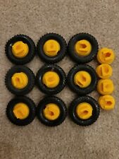 Vintage Construx 9 yellow wheels with black tires, 4 extra hubs