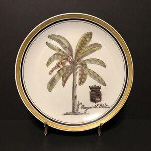 "Raymond Waites 10-1/4"" Decorative Wall Plate Image of Palm Tree w/Crest on White"