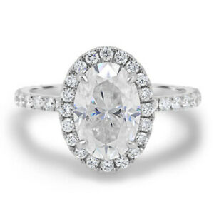 2.66 TCW Oval Cut Moissanite Halo Engagement Ring In 14k White Gold Plated