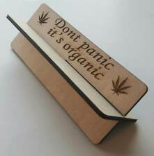 Wooden rolling up stand with slogan on 'Don't panic, it's organic'  tobacco weed