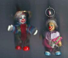 deux clowns  porcelaine - bon état -- un porte clefs / un simple a poser