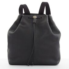 THE ROW black pebble leather drawstring logo medallion canvas strap backpack bag