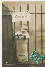 C3685 1910 RPPC PHOTO POSTCARD BABY ON FENCE  A VENDRE LITTLE STORY
