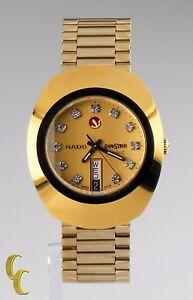 Rado DiaStar Magic Day/Date Gold Tone Watch w/ Swarovski Hour Markers 636.0313.3