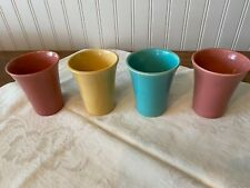 """Four Vintage Bauer Tumblers 4"""" high in desert beige, turquoise and butter cream"""