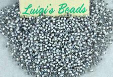 11/0 Round TOHO Japan Glass Seed Beads #261-Rainbow Crystal/Gray Lined 10 grams