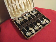 CASED SET OF 6 CONTINENTAL 800 SOLID SILVER SIAMESE DECORATED TEA SPOONS.
