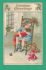 1910 CHRISTMAS POSTCARD GIRL HUGS DOLL IN CHAIR TEDDY BEAR DOLL BALL HOLLY