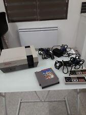 Console Nintendo nes + 2 manettes d'origine + câbles d'origine + 1 jeu en loose