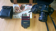 1980's Canon T70 camera with large travel case lens flash and instructions