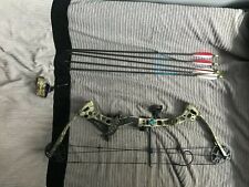 Diamond Razor Edge Compound Bow with arrows, carrying case and wrist strap.