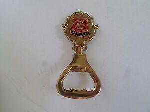GOOD Vintage Brass Bottle Opener With Enamelled Jersey Crest Badge Shield