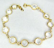 Swarovski Swan Signed Clear Faceted Crystal Gold Tone Bezel Tennis Bracelet.