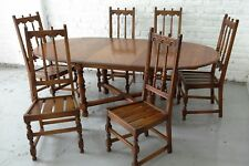 Ercol Old Colonial Elm Top Oval Extending Dining Table and Six Chairs