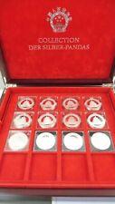 Konvolut 10 Yuan Panda Silbermünzen, 9 x 1oz / 3 x 30g, 12 Münzen / Box