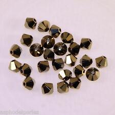 50 perles  toupies en cristal de Swarovski  5328 crystal dorado 2X 4 mm