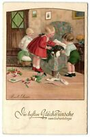 Pauli Ebner girls with sick Dachshund Teckel dog artist signed postcard 1934