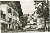 """D OBERAMMERGAU, 1955 s/w RP AK """"Dorfplatz mit Hotel Wittelsbach"""", gebraucht, TOP"""