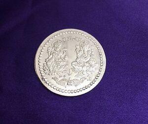 Shree Lakshmi Ganesh Puja Coin - Lord Ganesha and Goddess Laxmi White Metal Coin