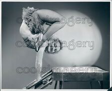 Limber Woman Wearing Fishnet Stockings Heels Rolls Herself Up Press Photo