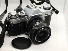 Canon AE-1 35mm SLR Film Camera with FD 50mm Lens - Silver