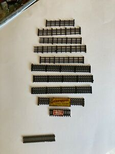 10 LENGTHS OF OO GAUGE MODEL RAILWAY FENCING AND TWO WITH ENAMEL SIGNS
