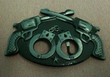 Double revolver and hand cuffs belt buckle