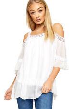 Ropa de mujer de color principal blanco de seda talla 38