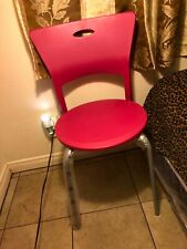 modern pink chair (person does not come with chair)