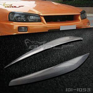 Carbon Fiber Eyebrow Eyelid Headlight Cover for Nissan Skyline R34 GTR GTT 99 02