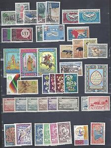 ALGERIA 1957 63 COLLECTION OF 29 COMPLETE MINT SETS NEVER HINGED & LIGHT HINGED