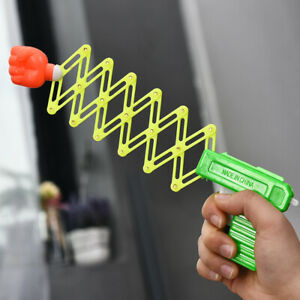 Retractable Fist Shooter Trick Toy Gun Funny Child Kids Elastic Telescopic Toy